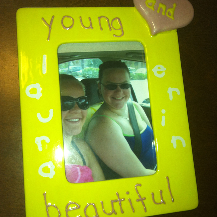 "I was visiting Erin in South Carolina when we took this picture. We made the frame when she was visiting Arizona almost 10 years ago. It says ""Young and Beautiful"" because Carrie Underwood was the soundtrack of our trip."